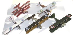 Four biplanes and a triplane by SarienSpiderDroid