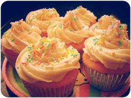 Vanilla Rainbow Cupcakes by SkelloKitty