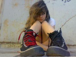 a girl with sneakers by emotionalxlife