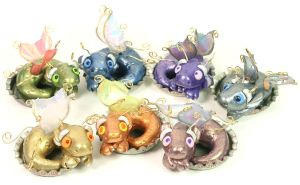 Bottle Cap Fairy Dragons by CatharsisJB