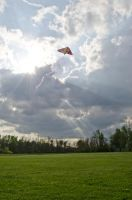 Kite In Sky with Sun Rays by CarolineRutland