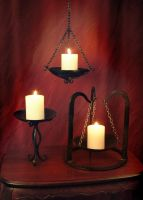 A set of three candle holders by Rajala