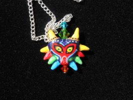 Majoras Mask Necklace-for sale by JenniferSlattery