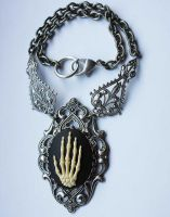 Skeleton hand necklace by Pinkabsinthe