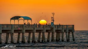 Sunrise over the coral rocks jupiter florida by for Lake worth pier fishing