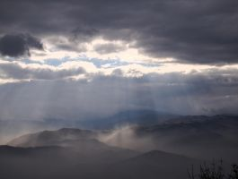 Sun rays kissing the hills by bellaricca