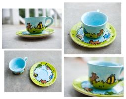 Frolicking Cup and Saucer by someweirdcrab