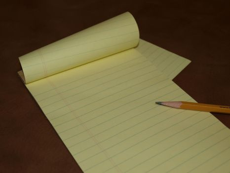 Legal Pad (Small Yellow with pencil) Stock Photos by Justturtle