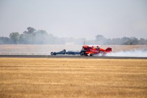 Biplane and Rocket Car 1 by RogueAce