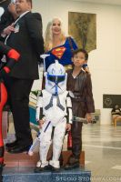SuperGirl with a little clone trooper and jedi by Stormfalcon