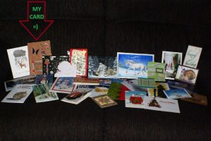 DA Holiday Card Project - Pointing out my card. by CalicoWoolfe