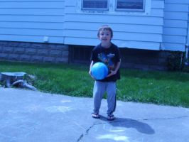 Kaleb Holding Ball by Unmiracle-stock