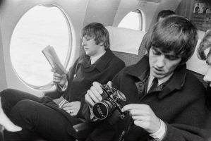 Ringo and George on a plane. by georgia-mcrmy
