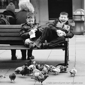 Feeding Pigeons, Feet Up by EarthHart