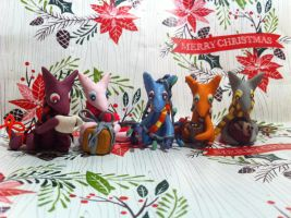 Christmas Foxes by Cyborg-Pengiun