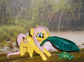 Fluttershy A Helping Hoof with rain no.2 by MadPonyScientist
