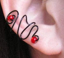 Red Eye Ear Cuff by lavadragon