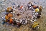 Earth tone Glass Lampwork Charm Bracelet by DesignsByCheree