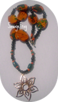 Pumpkin Flower Necklace by SavageFrog