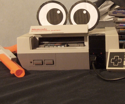 NES with eyes by Deavas