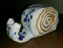 a snail made out of clay by Schrucy