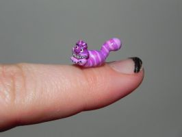 Cheshire Cat miniature, work in progress, bottle by Secretvixen