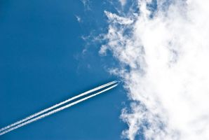 Sky and plane by Quinnphotostock