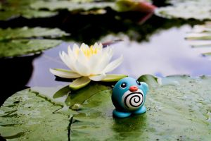 Poliwag in a lotus pond by MemiorsOfAnOtaku