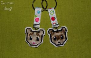 My furry ferrets as cross stitch keychains!! by inu-chan-free