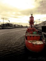 Red Boat on the Liffey by ronankelly