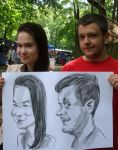 Caricature of a couple with charcoal by Mandala87