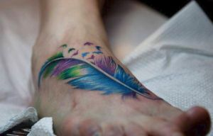 feather II by evilmoon-tattoo