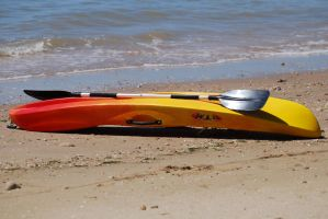 Beached Kayak by 10000Greetings