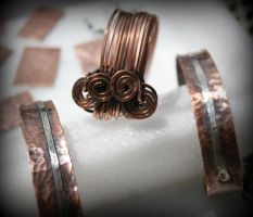 Hand forged copper and sterling cuffs bracelets by ReneeRutherford