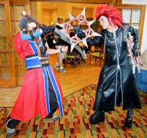 Auron vs. Axel by wingedlight