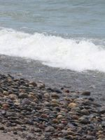 Wet Rocks Busy Surf by zomberinacontagion