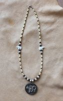 White bear necklace by lupagreenwolf