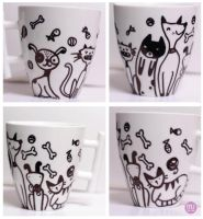 Cats and dogs teacup by mjdaluz