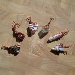 Wire-wrapped pendants by Swirlything