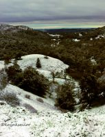 valley view with snow by kayaksailor