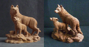 Wolf and cub: fossil carving by goiku