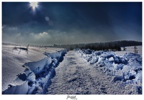 A road in the snow by deaconfrost78