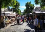 Busy street down Bercy Village by EUtouring