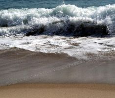 The waves wash away by LadyBrittany