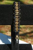 Black and Gold Enigma Bracelet by ydoc16