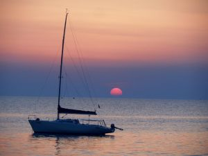 Boat under the setting sun by *Paul774