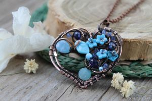 Blue heart pendant by Schepotkina