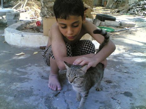 Hussain playing with tha cat by fofosilver