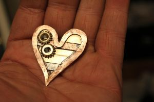 copper and brass heart with cogs by connerchristopher
