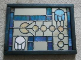 Stained glass Pac Man mirror in Art Deco style by vulpinedesigns